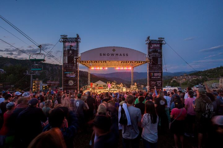 Snowmass concert stage, with crowd of people, at dusk